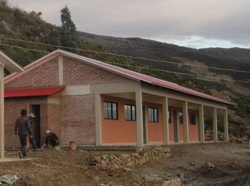 Staff from our counterpart organization  Mano a Mano Bolivia working on the Guitarrani school.