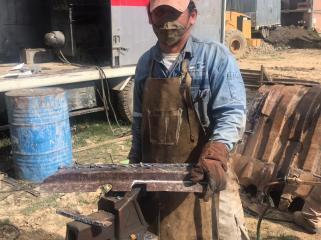 Repairing an excavator bucket section.