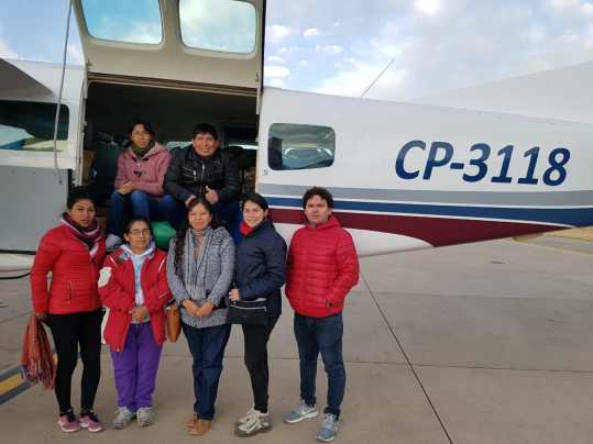 Carmen and volunteer dentists getting ready for a weekend health clinic on the Mano a Mano plane.