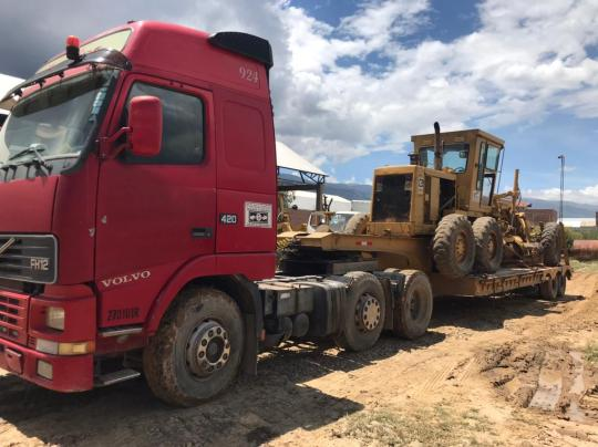 Transporting heavy equipment from Cochabamba to Toro Toro to start construction on the airstrip.