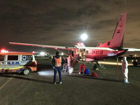 Transporting the patient to Santa Cruz (here at Viru Viru airport) for care.