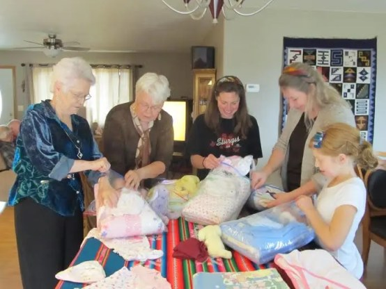 Van Goor family sorting and packing layettes.