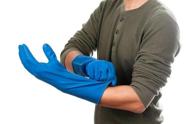 how to clean brick floor - rubber gloves