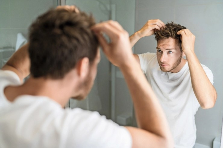 Man with short haircut Styling Hair