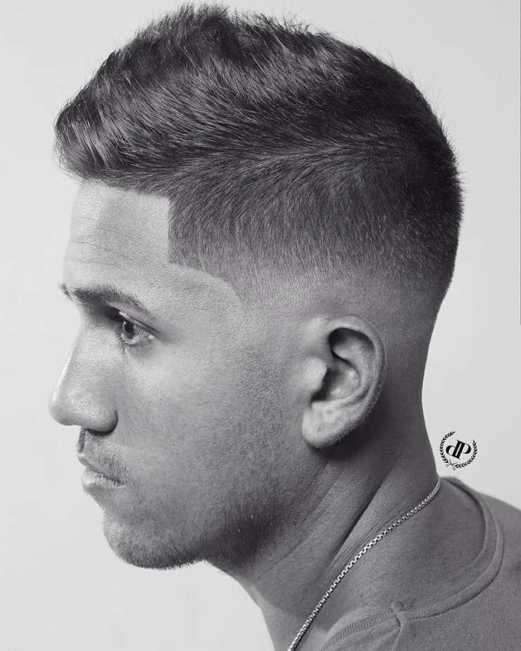 short back and sides haircut with longer fringe on top on man