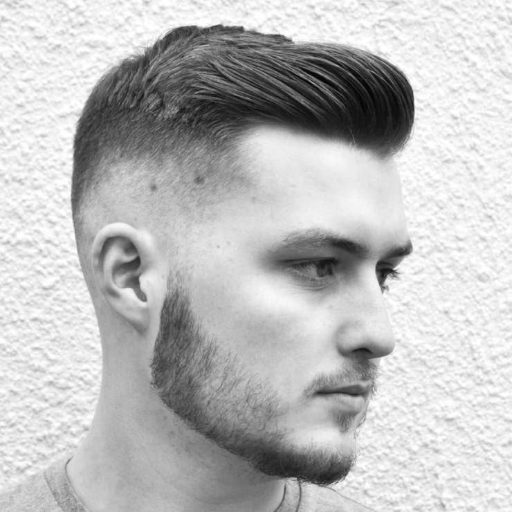 short skinfade with slick back hair on male model