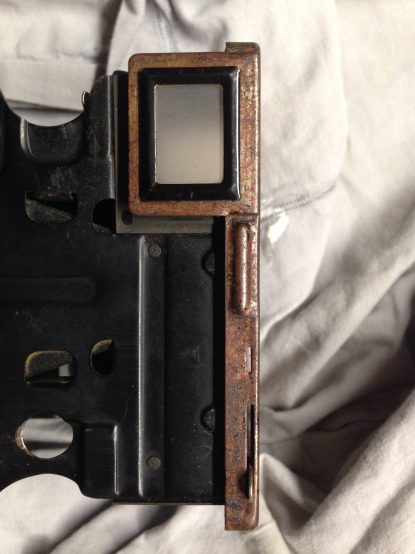 Left view. The viewfinder as been kept as is, in good original state.