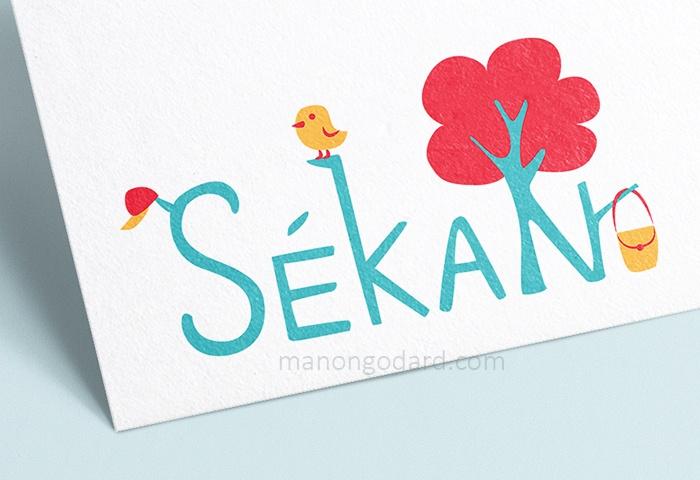 Logo pour la marque SeKaN, entrepreneuse créatrice de sacs, couturière. Graphiste : Manon Godard