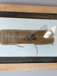 Spine of old detective book with noirish drawing