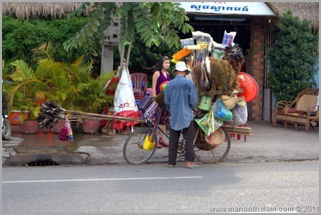 Man with overloaded bike