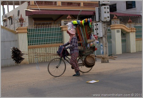 Woman with overloaded bike