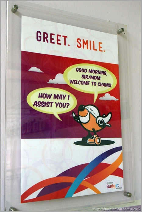 Singapore Changi Airport -- Greet, Smile, Thank program sign -- greet and smile airplane logo