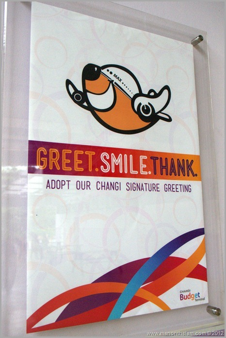 Singapore Changi Airport -- Greet, Smile, Thank program signs