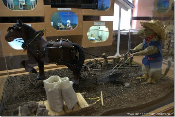 Farming with horses stuffed gopher at Gopher Hole Museum, Torrington Alberta