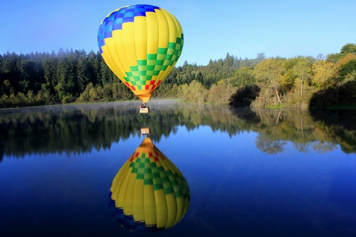 Man On The Lam Top 100 Travel Blog Posts of 2015 so far by social media shares  Hot air balloon and reflection in lake