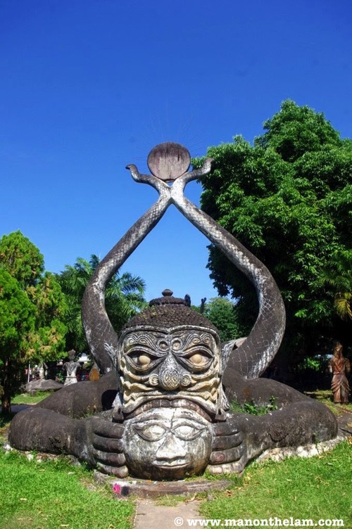 Front view of grumpy merman Hindu statue Buddha Park Vientiane LaosJPG