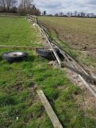 Repairing fencing alongside the boundary line(before) Green Lane 1
