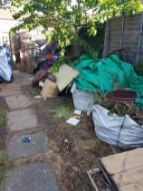 Clearing away old shed and rubbish preparing for concrete shed base Burnham-on-Crouch before 1