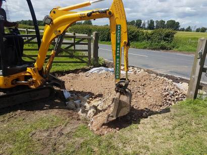 Digging out a bell mouth access into a field 4