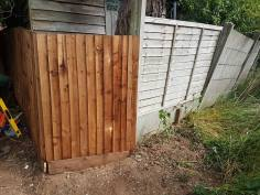 Replacement of a boundary fence( not straightforward as it's on a large hill before 7