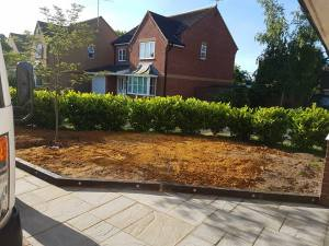 Rotovating leveling 1 and a half tons of good soil preparing to Turf front garden Burnham on Crouch 1