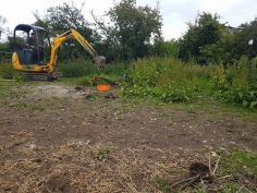 Scraping off finding levels and preparing for concrete base dengie marshes 1