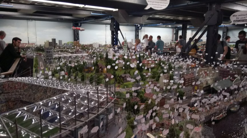 The view across the Hamburg area of Miniaturwunderland, with a plethora of protest placards!