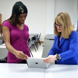 Professer Kathy Wright (right) working with a student.