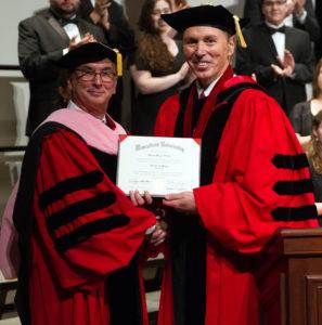 MU President Fran Hendricks presents an Honorary Doctor of Music Degree to Rob Fisher.