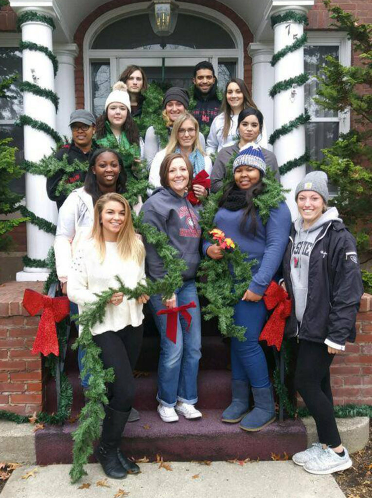 Rebecca Barton (center, front row) surrounded by Social Work students and Department Chair Tiffany Welch.