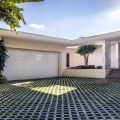 The house sits on a 12 150 square foot lot the driveway features hand