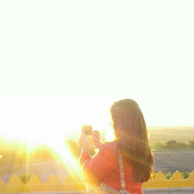Girl in the sunshine - sunset