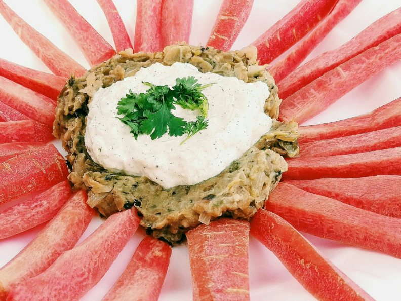 Eggplant Roasted dip with yogurt topping and carrot wedges