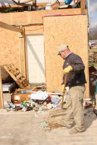 Trash and scattered belongings from damaged homes were swept out of the way as workers attempted to organize the madness of the storm's mess.