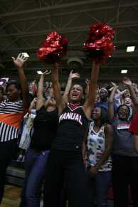 Jhanna Waddell's (12) cheers along side her peers. Photo by Jacqueline Leachman.