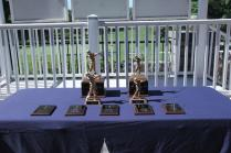Gold trophies for the tournament were proudly displayed in front of the Shawnee Golf Course for the girls' golf game. Photo by Noelle Pouzar