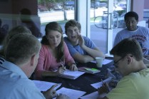 Mason Gersh (12) whispers to Emily Meffert (12)