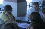 Boone Proffitt (12) and Mr. Jensen listen as Emily Meffert (12) explains the audition process for Idea Festival Manual