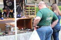 People browse and buy many different items sold at Irish Fest.