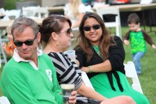 People talk and listen to the live performances at Irish Fest.