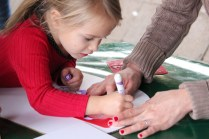 Children have arts and craft sessions outside the library, where they can draw freely or use stencils for their cardboard shields.