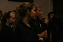 Students listen to the eulogy during the funeral. Photo by Alexis Weaver