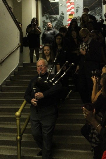 Former science teacherMr. Larry Fredericksen played the bagpipes before the eulogy. Photo by Taylor Ratliff