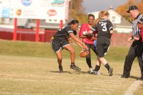 Aaliyah Mayfield (12) goes to catch the ball after it was dropped by Kristin Mudd (12).