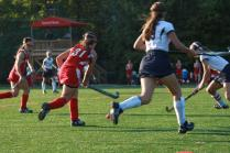 Anna DuFour (11) runs with the ball, keeping it away from Sacred Heart.