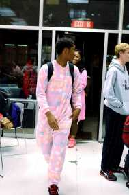 Mason Allen (12) strolls into the senior cafeteria, dressed in pink footie pajamas ready for the day. Photo by: Jack Steele Mattingly