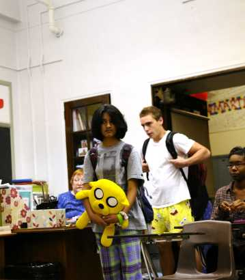 Parker McGuffey (11) and Saiara Mashiat (11) walk in to their homeroom ready for the PSAT. Photo by: Jack Steele Mattingly