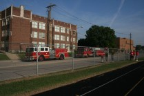 Louisville's Metro Fire Department trucks arrive on scene as they try to assess the situation. Photo by Miracle Stewart