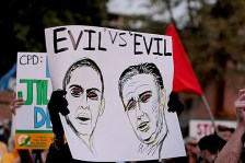 Protesters made Mitt Romney and Barack Obama out to be one in the same type of evil, and claimed our country would fail with either elected.