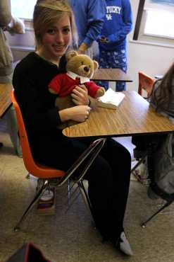 Madison Satterly (11) cuddles her Teddy Bear after taking the PSAT.